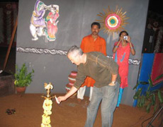 Dr. Arnold lights the flame of knowledge at a party in his group's honor in Bangalore