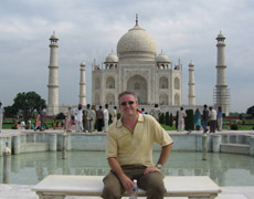 Dr. Arnold in front of the Taj Mahal.