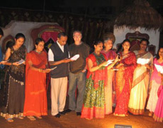 Dr. Arnold joins the group of dentists singing traditional Indian songs at the party in Bangalore.